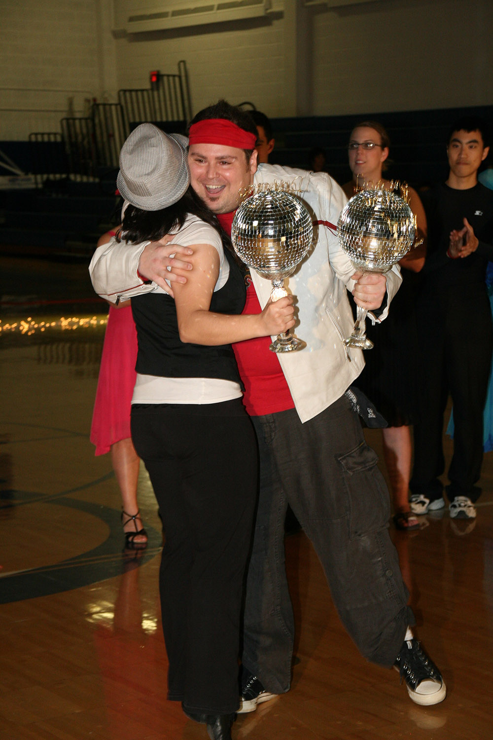 dance marathon at case western reserve university dancing with the CWRU stars ryan keytack bianca rodriguez trophies